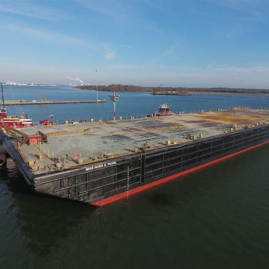 Miss Nora G. Pearl  Deck Barge  Built 1979  Flag USA/Dover, DE  16,322MT DWT Draft- 4.6 meters  LOA- 121.92 meters  Breadth- 31.94 meters